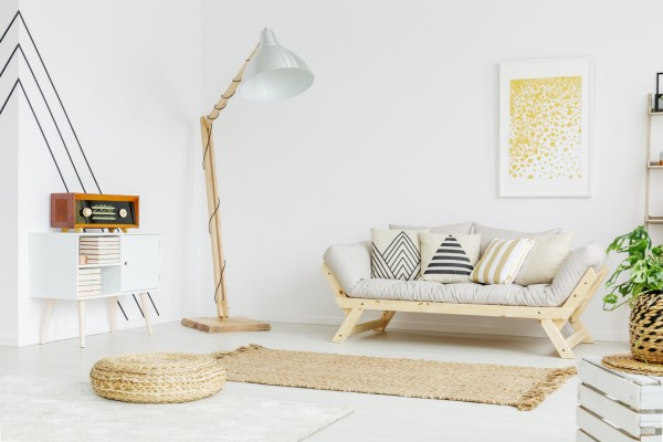 Big wooden lamp standing in the corner of the room
